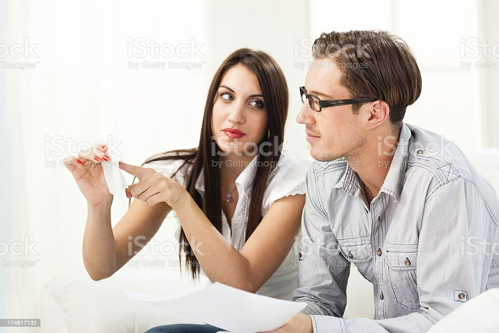 Woman showing bill to a man royalty-free stock photo