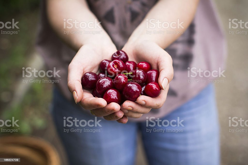 Woman showing cherry royalty-free stock photo