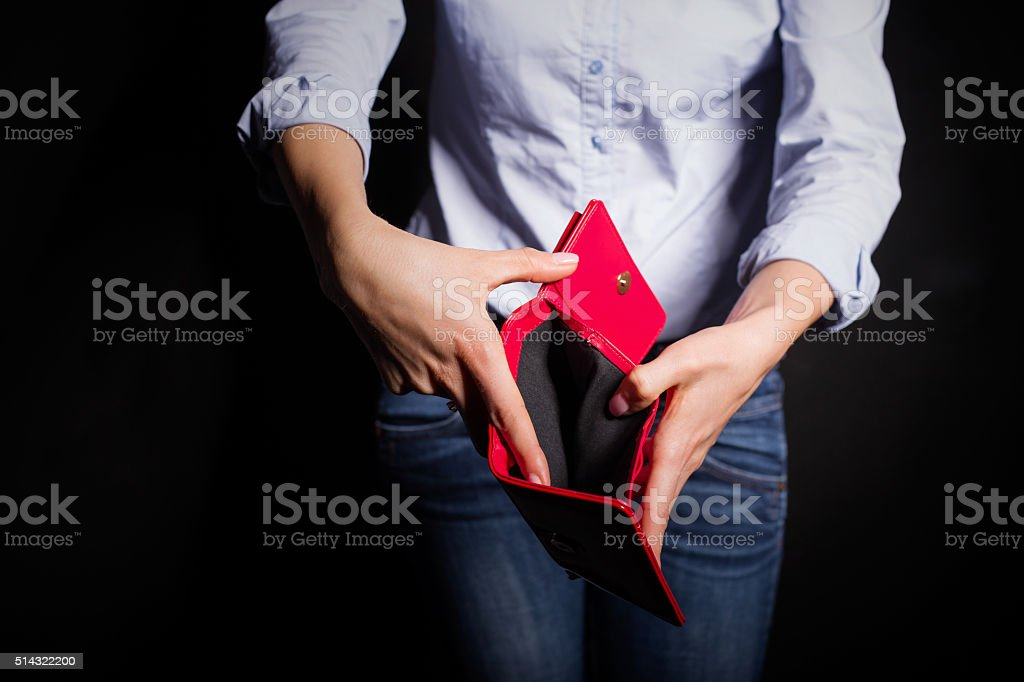 Woman showing empty wallet stock photo