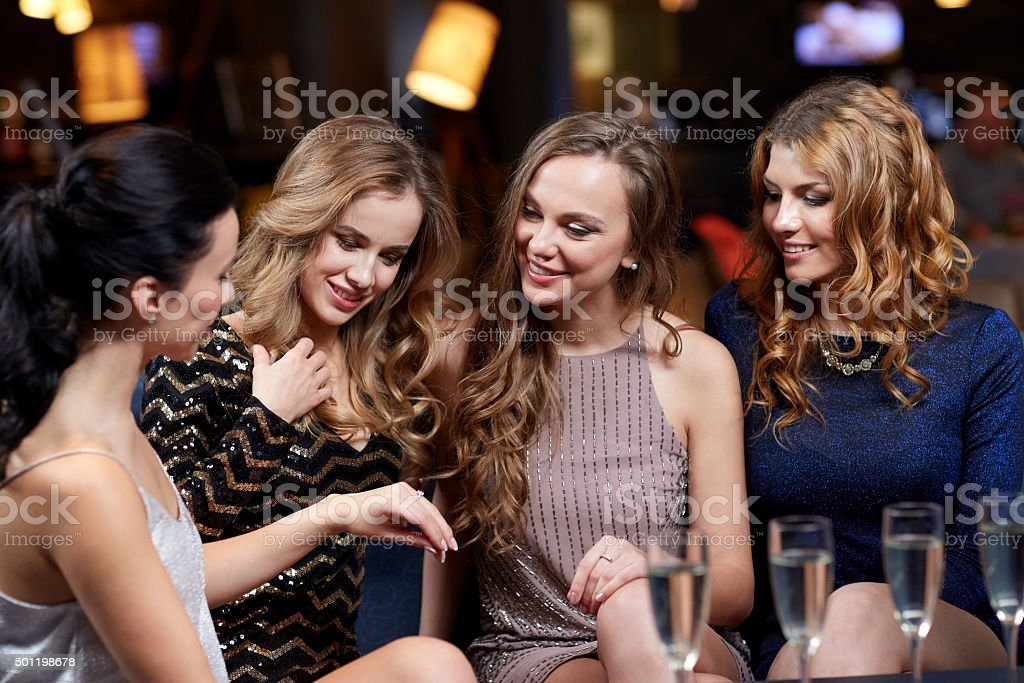 woman showing engagement ring to her friends stock photo