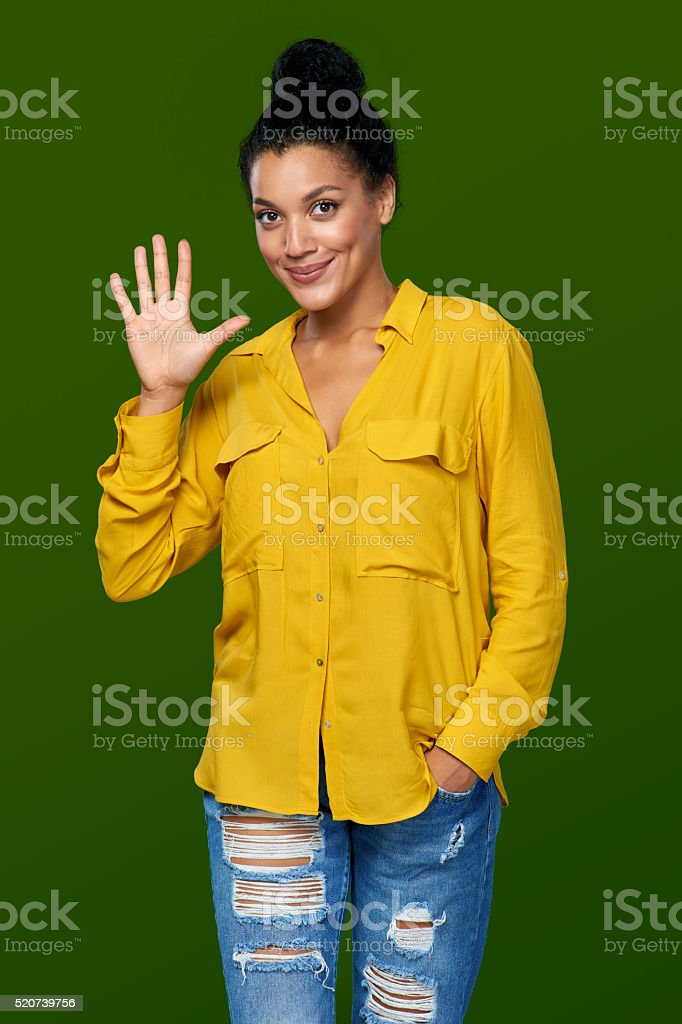 Woman showing five fingers stock photo
