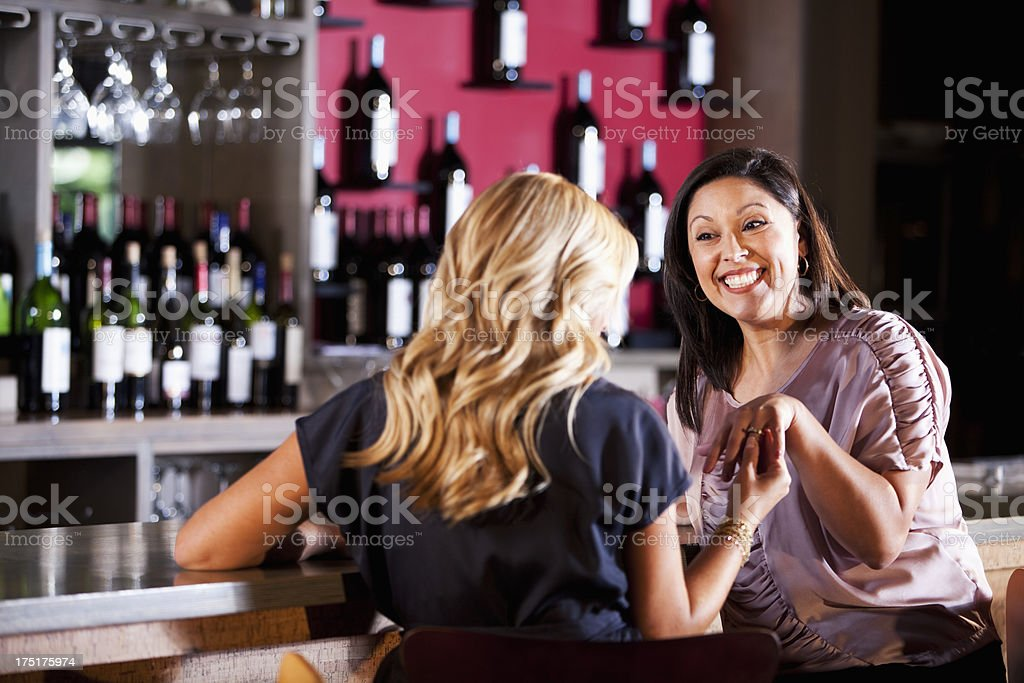 Woman showing friend engagement ring stock photo