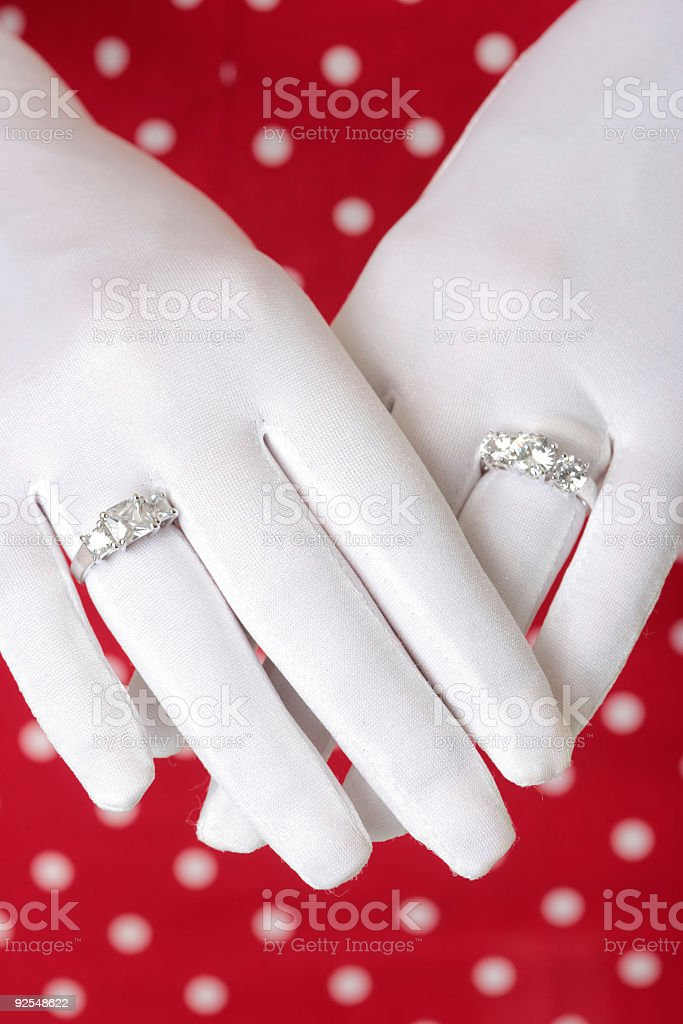 woman showing hands wearing two diamond rings royalty-free stock photo