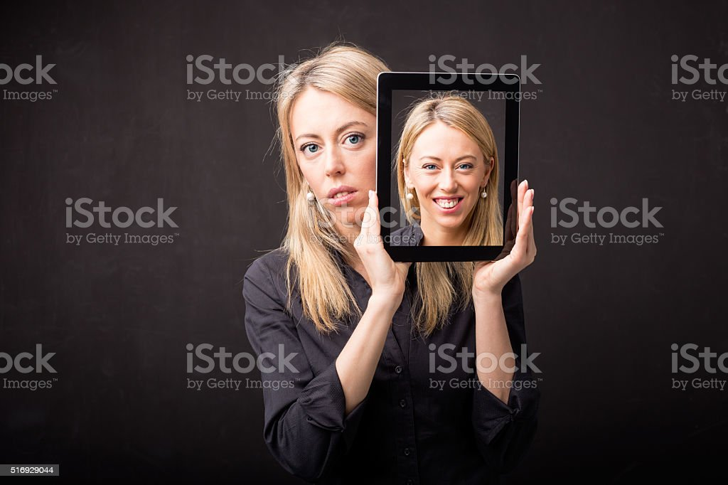 Woman showing happy portrait on tablet stock photo