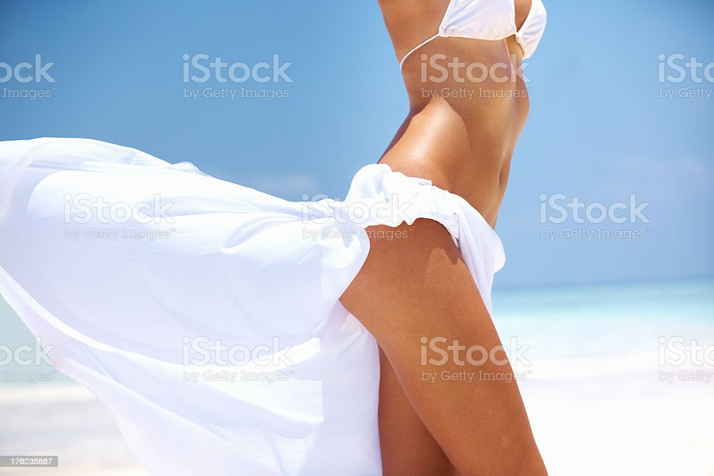 Woman showing her curvaceous body at beach stock photo