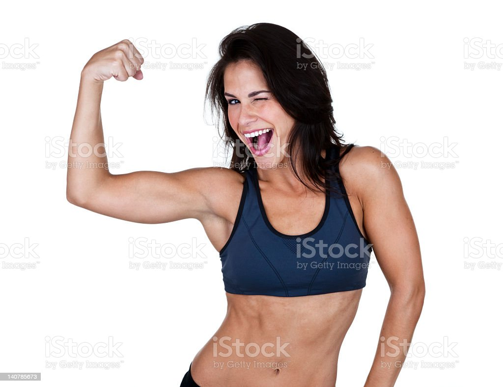 Woman showing her muscles and winking royalty-free stock photo