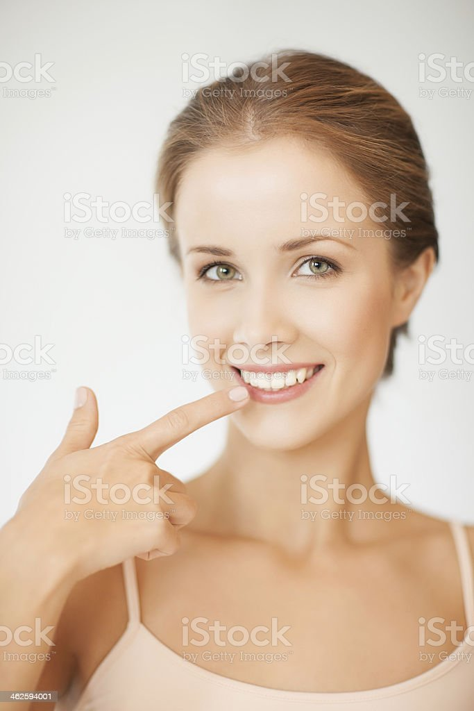 woman showing her teeth stock photo