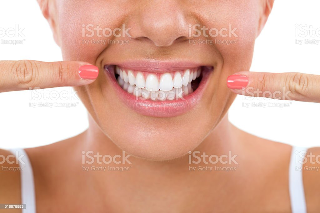 Woman showing her white teeth. stock photo