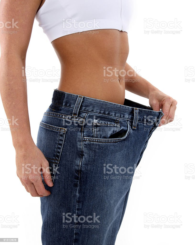 Woman showing how much weight she lost royalty-free stock photo