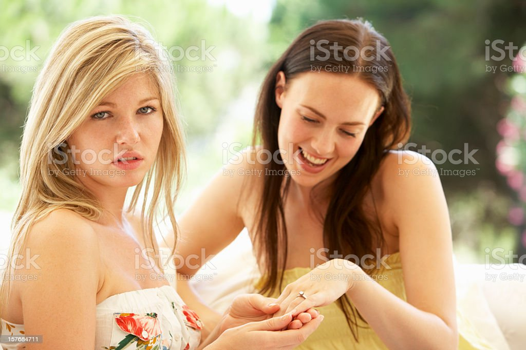 Woman Showing Jealous Friend Engagement Ring stock photo