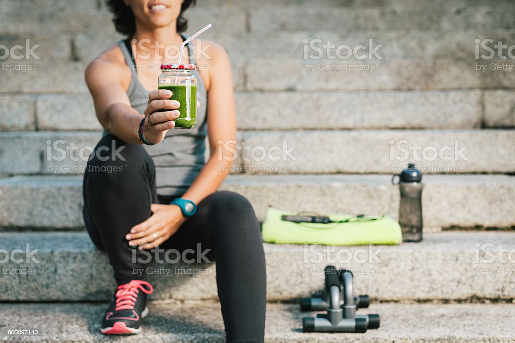 woman showing juice vegetable green detox cleanse smoothie stock photo