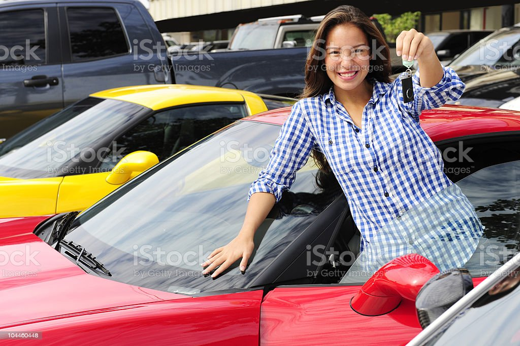 woman showing key of new sports car royalty-free stock photo