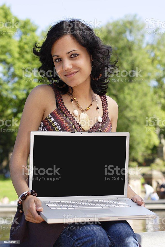 Woman Showing Laptop Screen royalty-free stock photo