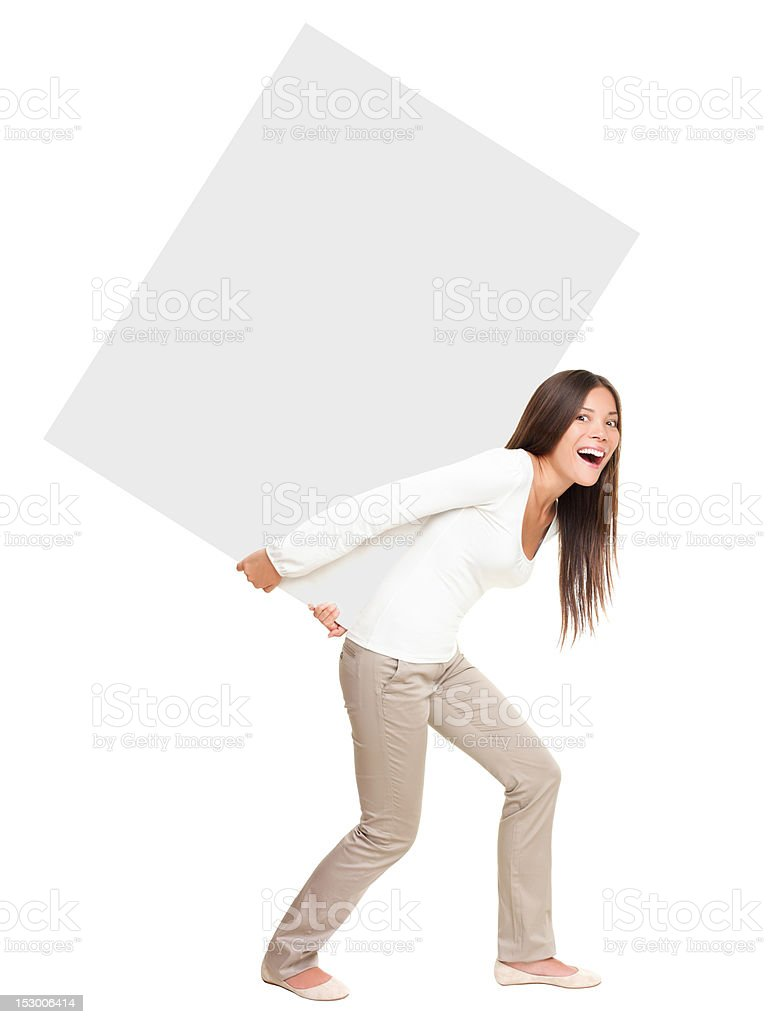 Woman showing / lifting heavy sign stock photo