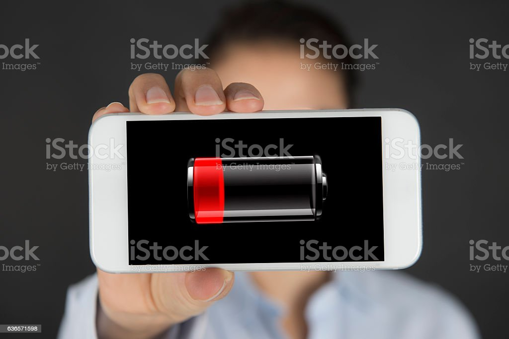Woman Showing Low Battery Icon In The Smart Phone Ccreen. stock photo
