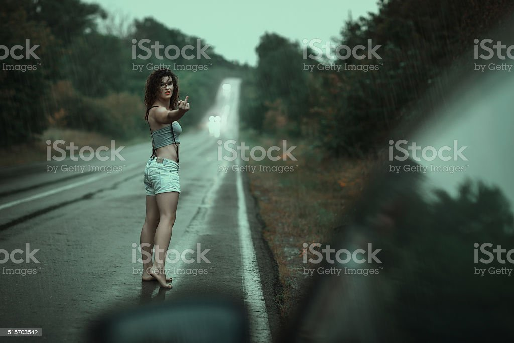 Woman showing obscene gestures. stock photo