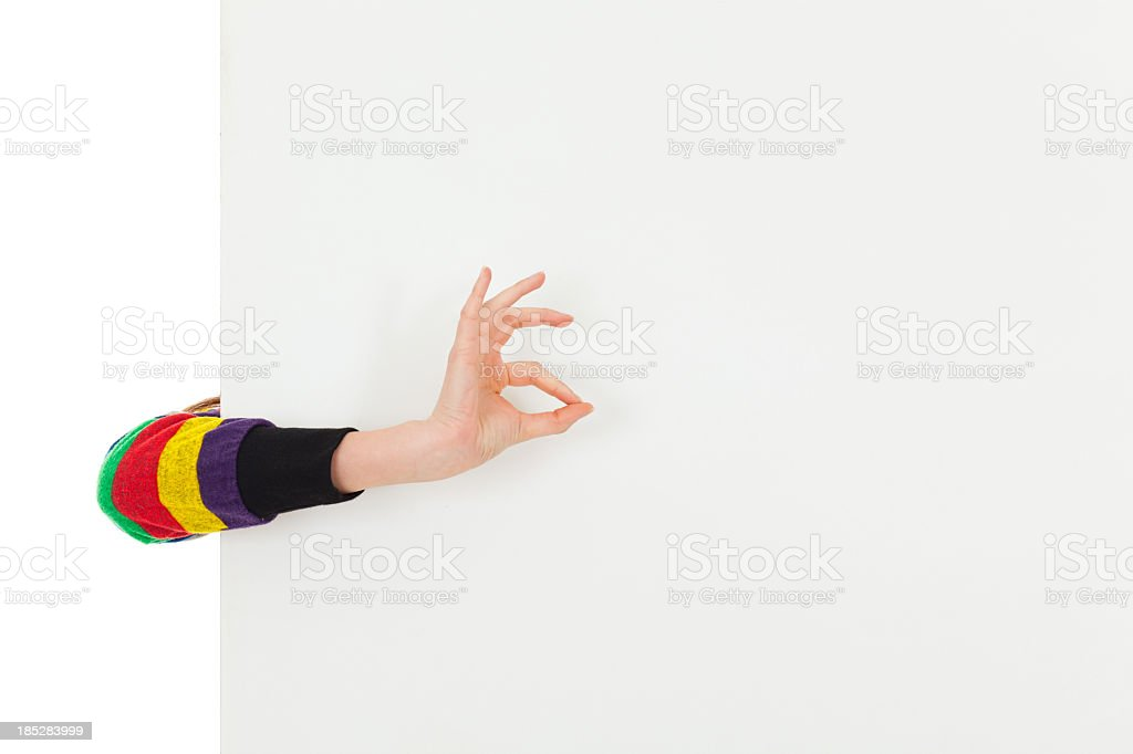 Woman showing OK sign in front of blank banner stock photo