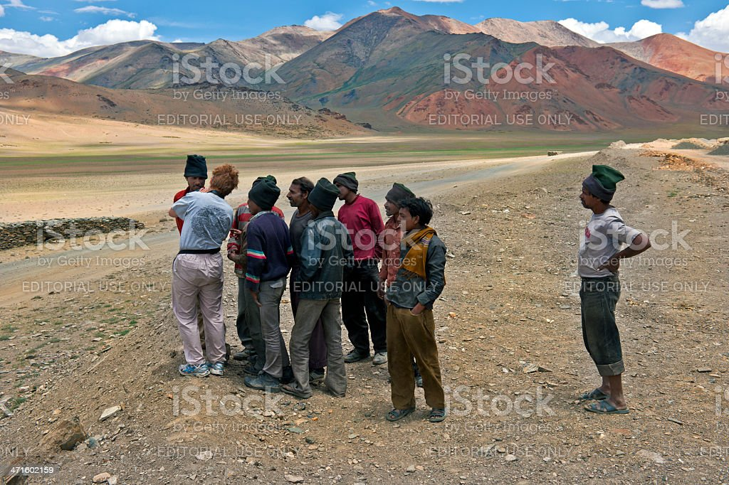 Woman Showing Photographs to Indian Men on More Plains India royalty-free stock photo
