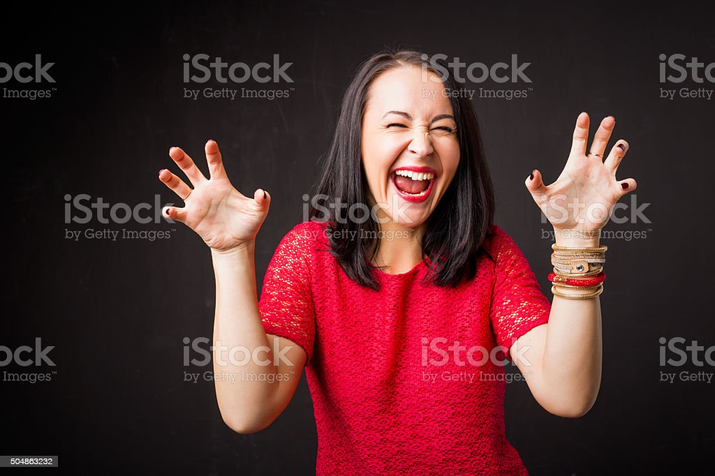 Woman showing scary face stock photo