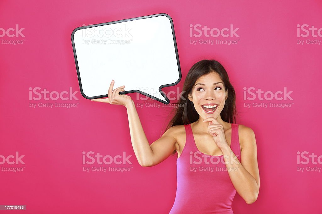 Woman showing sign speech bubble stock photo