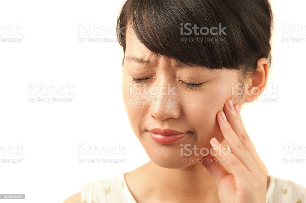 A woman showing signs of a toothache stock photo