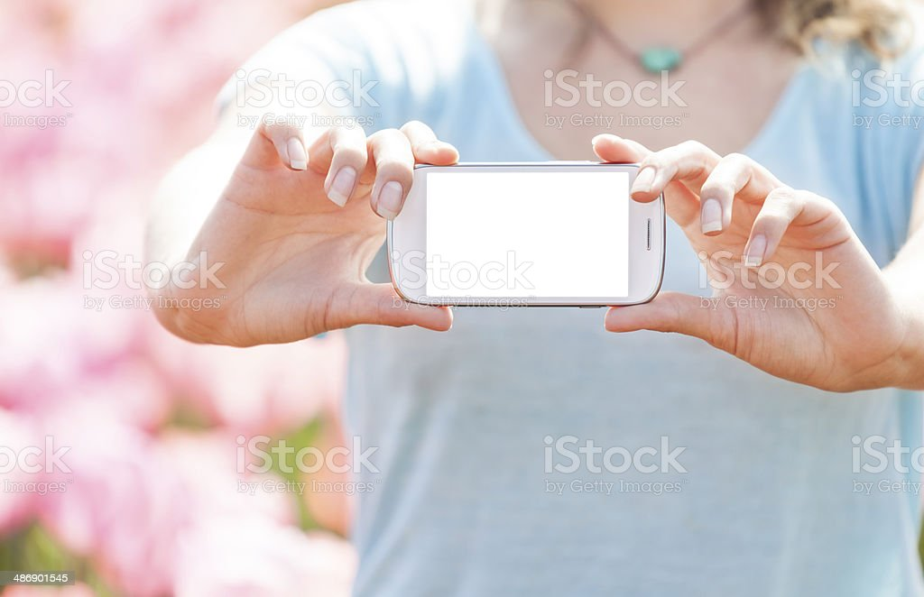 Woman showing smart phone stock photo