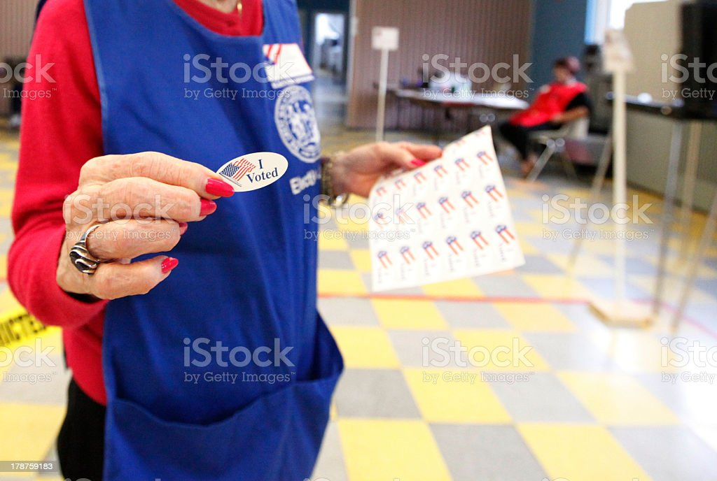 Woman showing the I voted sticker stock photo