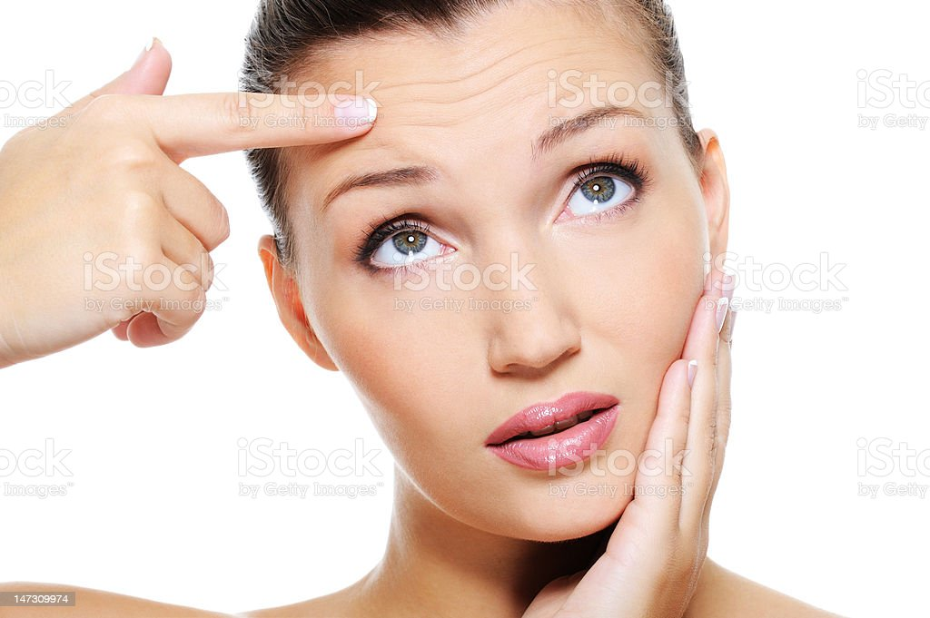 woman showing  the wrinkles stock photo