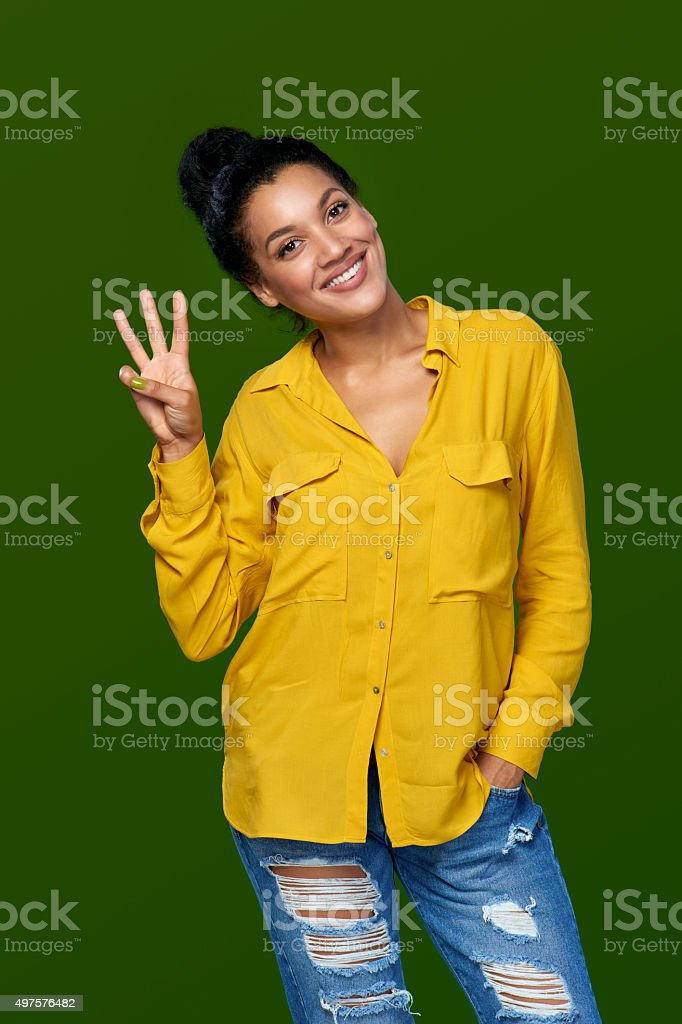Woman showing three fingers stock photo