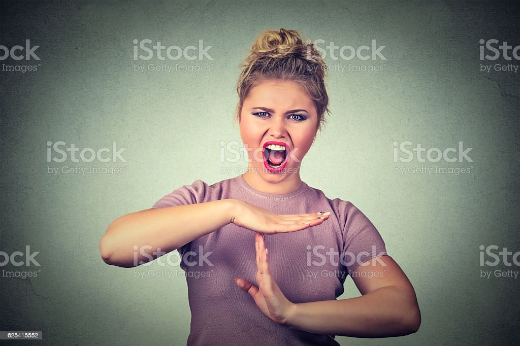 woman showing time out hand gesture frustrated screaming to stop stock photo