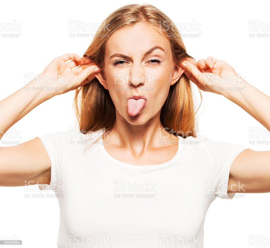 Woman showing tongue stock photo