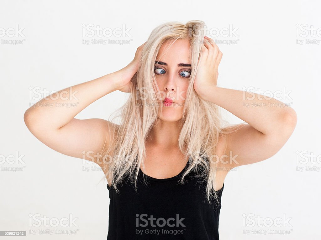woman shows a squint and fooling around stock photo