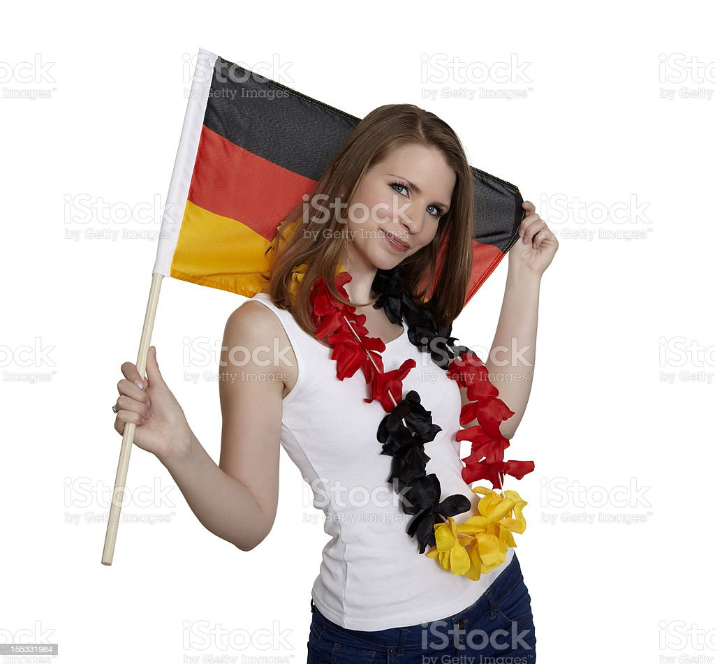 Woman shows german flag and smiles royalty-free stock photo