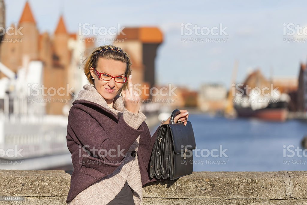 Woman shows gesture 'fuck off' royalty-free stock photo