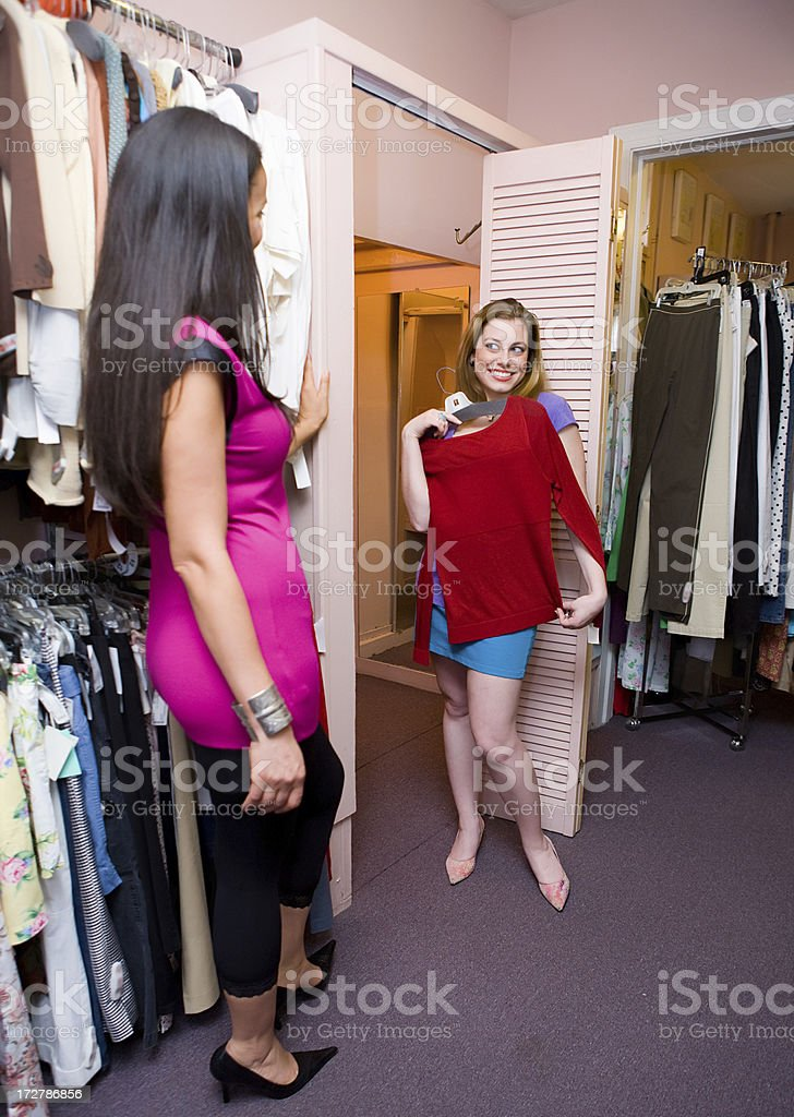 Woman shows her friend a blouse royalty-free stock photo