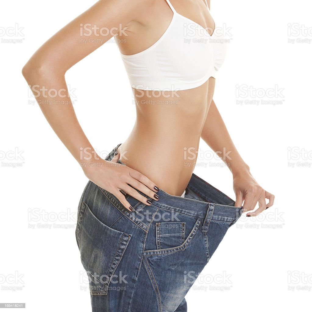 woman shows her weight loss royalty-free stock photo