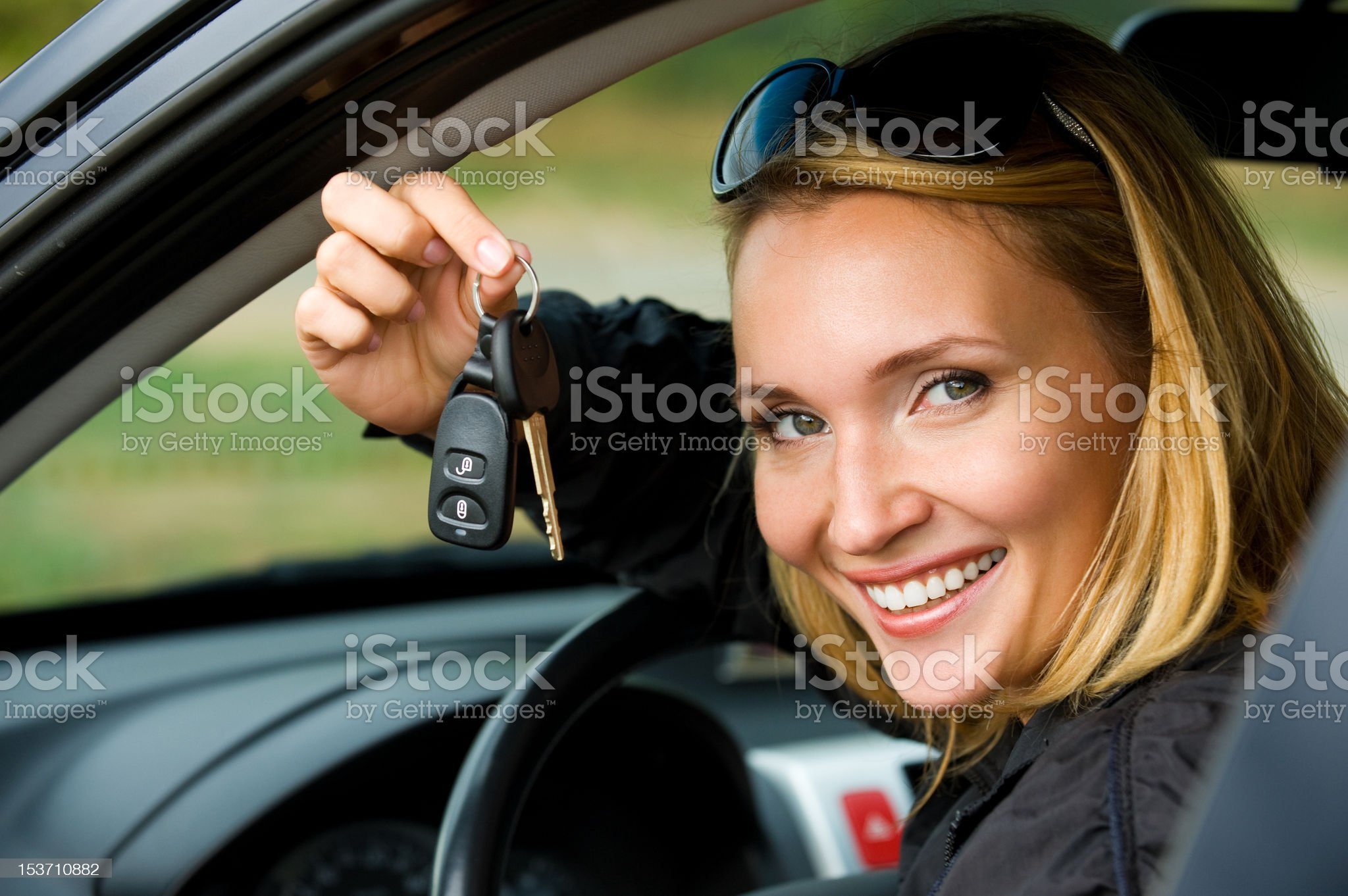 woman shows keys from the car royalty-free stock photo