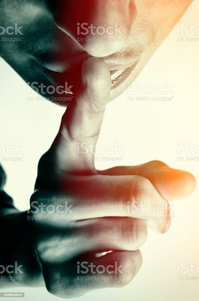Woman shows silence sign stock photo