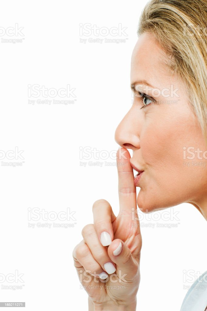 Woman Shushing Someone to the Side stock photo