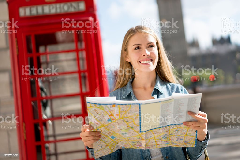 Woman sightseeing in London holding a map stock photo