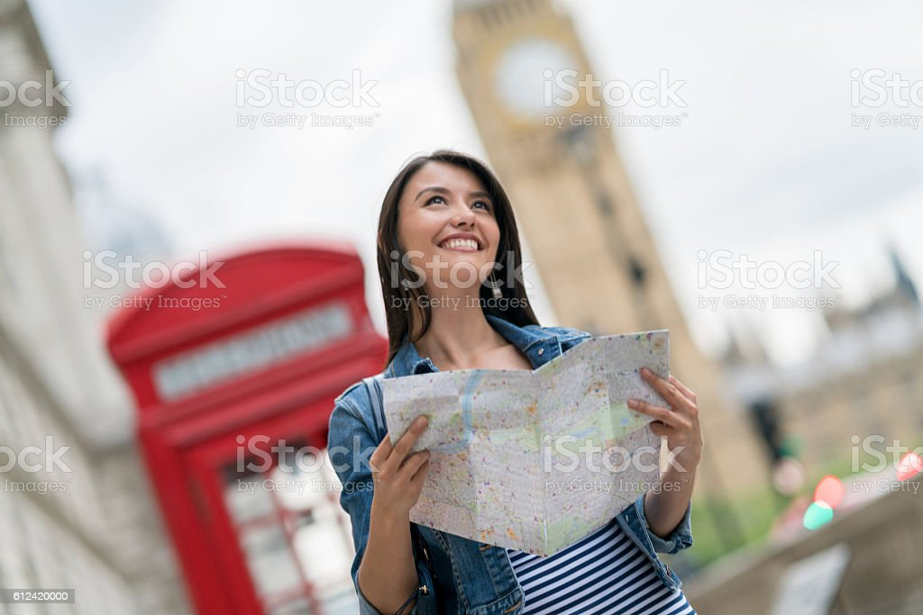 Woman sightseeing in London stock photo