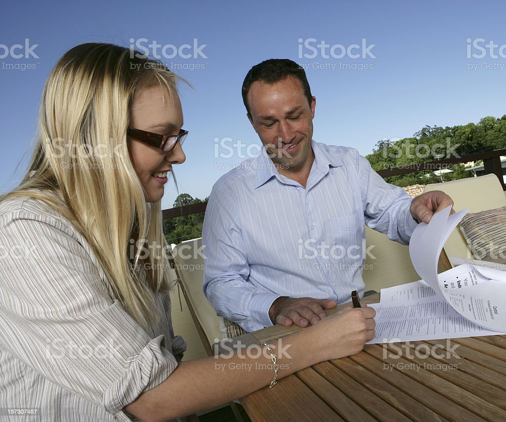 Woman Signing A Contract royalty-free stock photo