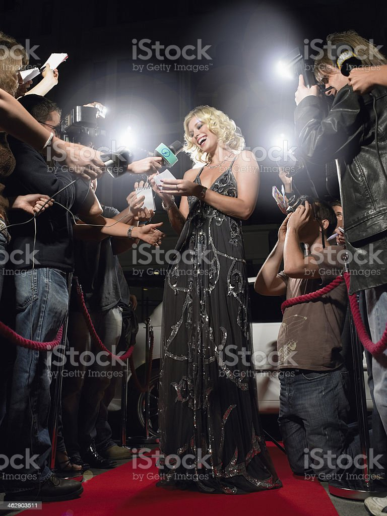 Woman Signing Autographs On Red Carpet royalty-free stock photo