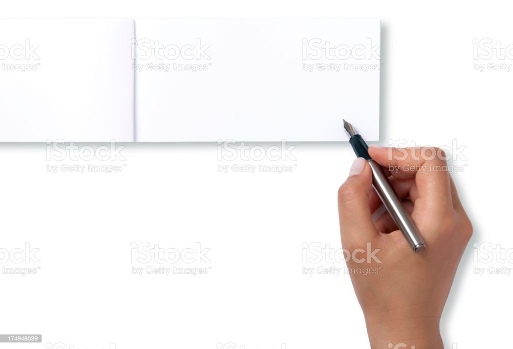 woman signing blank check book stock photo