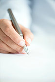 Woman Signing Contract Paper