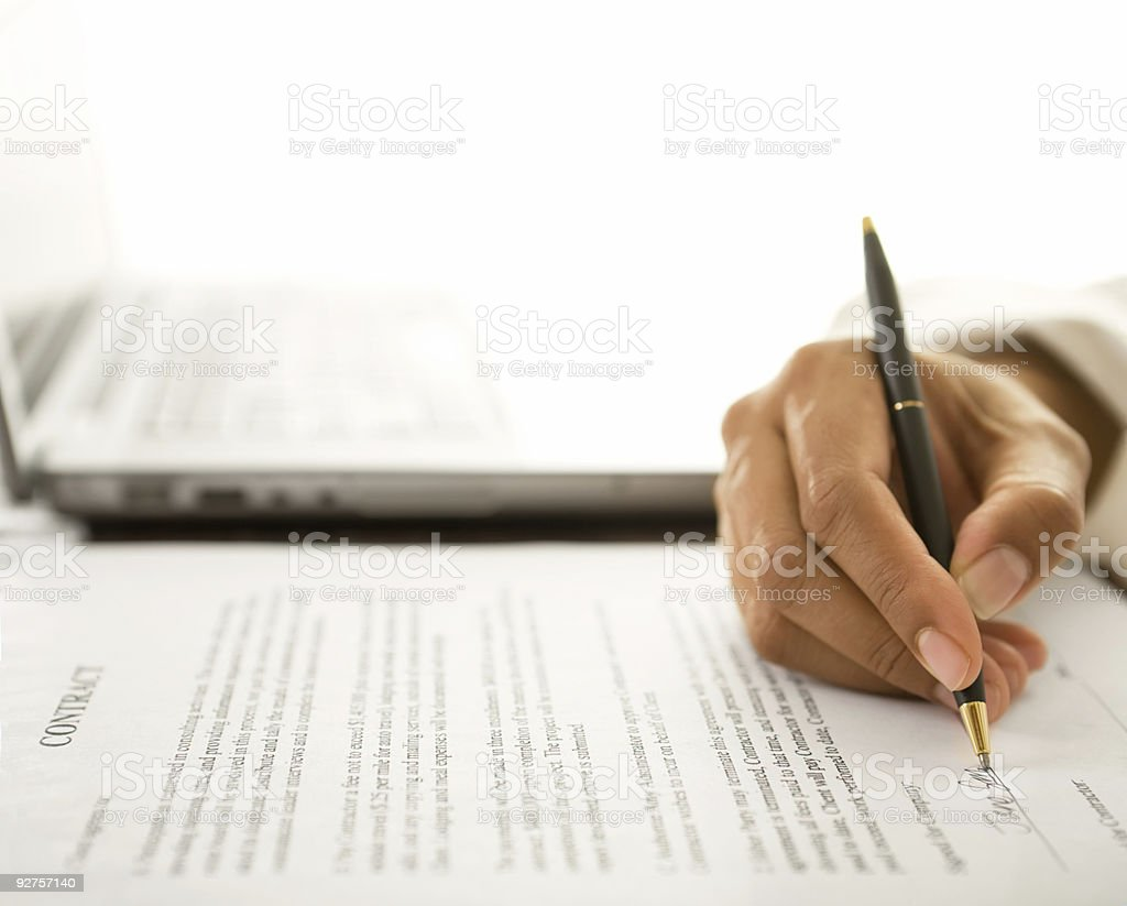 Woman signing contract royalty-free stock photo