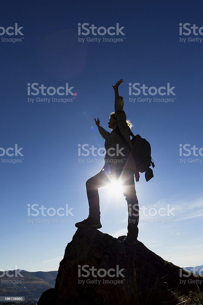 woman silhouette and  mountain sunset royalty-free stock photo