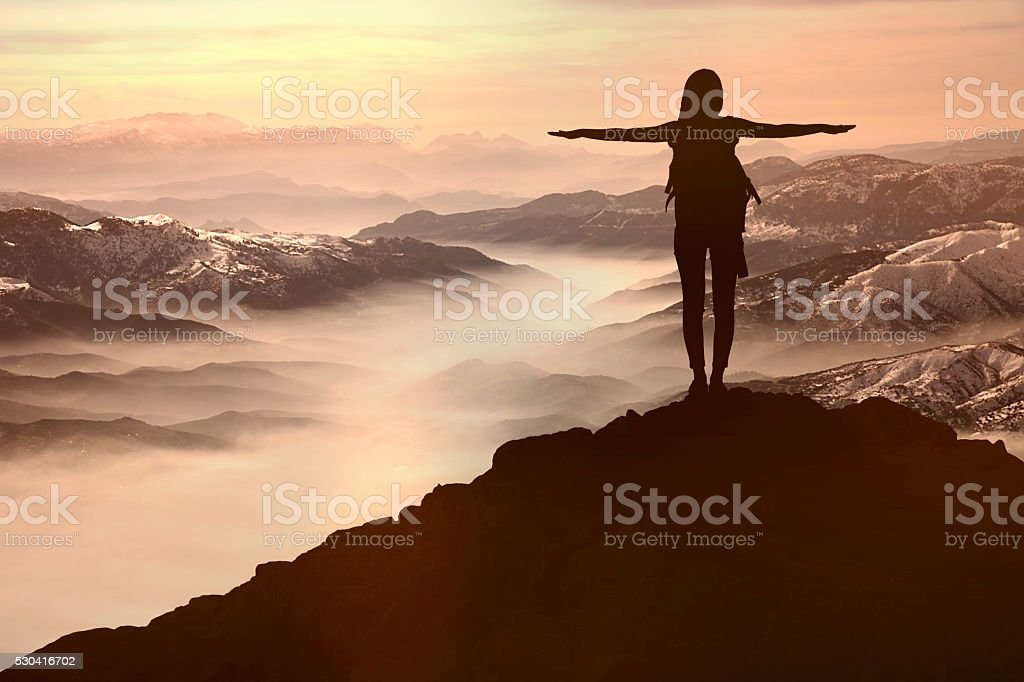 Woman Silhouette at sunset  on hill stock photo