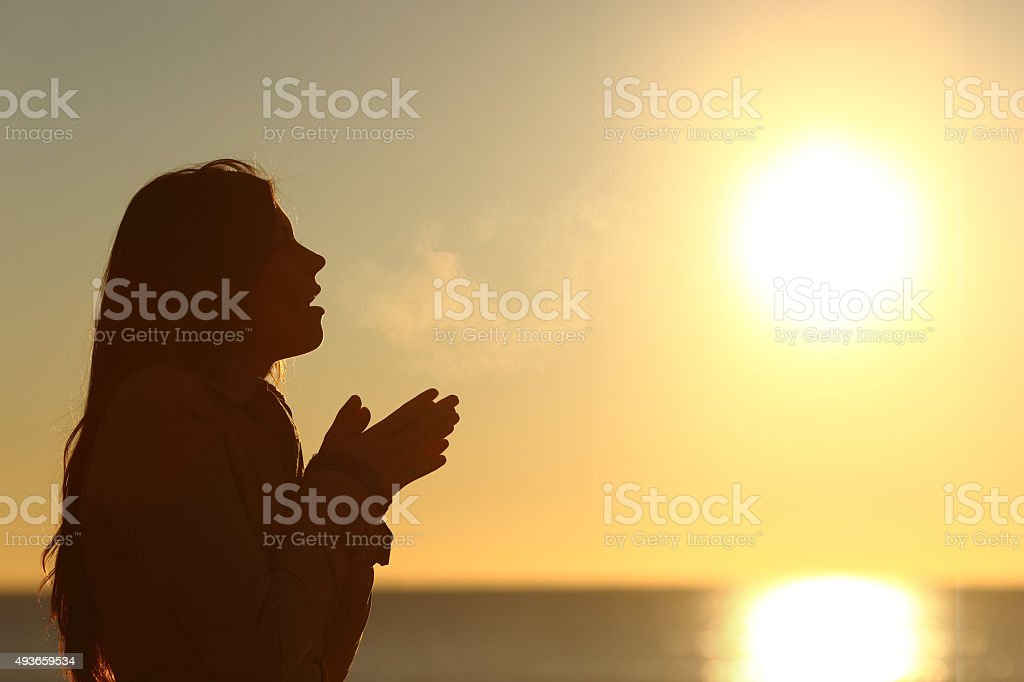 Woman silhouette breathing in a cold winter stock photo