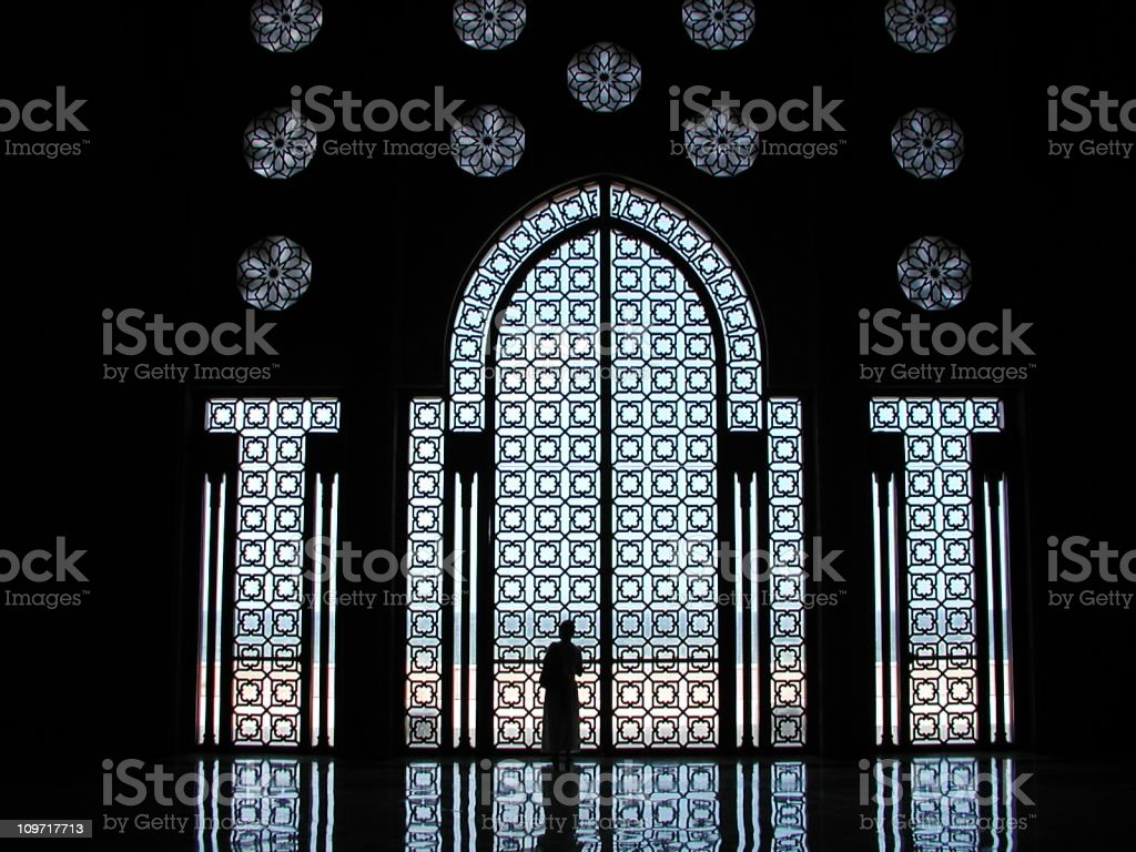Woman silhouette in mosque stock photo